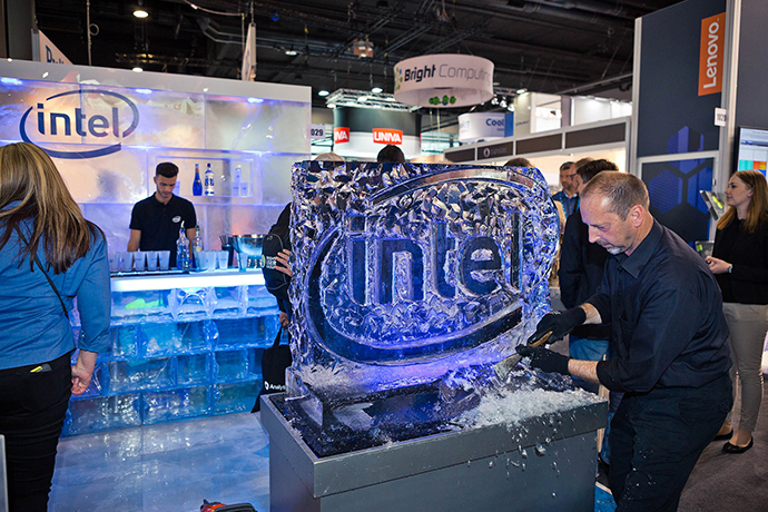 An ice sculptor carves the Intel logo into a frozen block on Monday, June 201, 2016 at ISC High Performance. At 2016 ISC High Performance in Frankfurt, Germany, Intel will introduce and showcase a range of new technologies helping to fuel the path to deeper insight and HPC's next frontier. The event runs June 19 to 23. (Credit: Paul Günther, Photodesign/Intel Corporation)